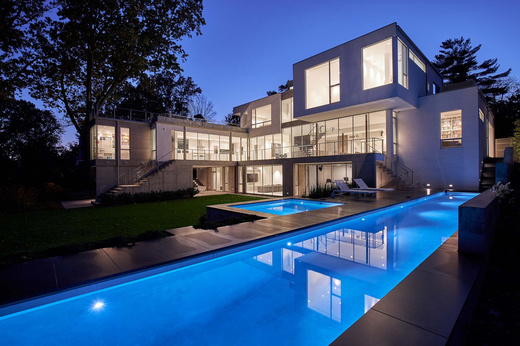 Modern House on Lake Carnegie - Rear Elevation at Twilight with Pool