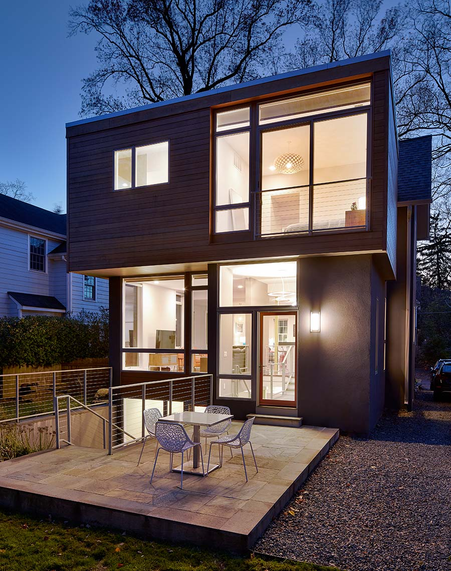 Victorian with a Modern Renovation - Rear Elevation at Twilight